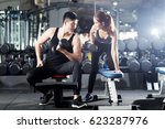 man and woman workout at... | Shutterstock . vector #623287976