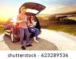 car trip and sunset time  | Shutterstock . vector #623289536