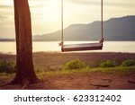 children swing in the park ... | Shutterstock . vector #623312402