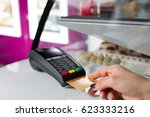 pos terminal in the shop. | Shutterstock . vector #623333216