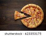 Sliced Hawaiian Pizza With...