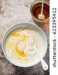 natural yoghurt with honey  | Shutterstock . vector #623395412