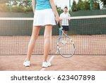 tennis players playing a match... | Shutterstock . vector #623407898
