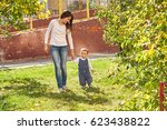 young mother playing with her... | Shutterstock . vector #623438822