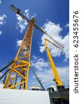 construction crane and concrete ... | Shutterstock . vector #623455676