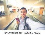 smiling handsome man traveler... | Shutterstock . vector #623527622