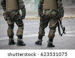 riot police with tear gas gun.... | Shutterstock . vector #623531075