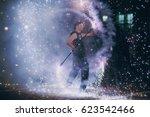 man doing tricks with fire | Shutterstock . vector #623542466