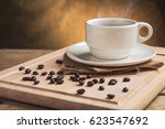 cup of coffee with coffee beans ... | Shutterstock . vector #623547692