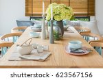 wooden dining table in modern... | Shutterstock . vector #623567156