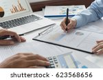 financial advisor team are... | Shutterstock . vector #623568656