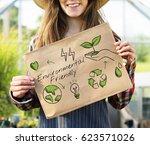 farmer woman holding go green... | Shutterstock . vector #623571026