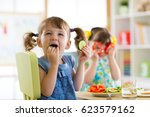 children kids eating vegetables ... | Shutterstock . vector #623579162