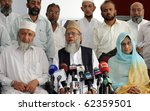 Small photo of KARACHI, PAKISTAN, OCT 04: Jamat-e-Islami (JI) Ameer, Syed Munawar Hassan along with Ismat Siddiqui, mother of Pakistani Neuroscientist Dr.Aafia Siddiqui, addresses press conference on October 4, 2010 in Karachi, Pakistan.