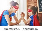 mother and her child playing... | Shutterstock . vector #623600156