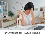 stressed tired woman at her... | Shutterstock . vector #623648666
