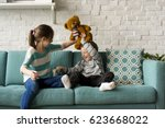 brother sister playing... | Shutterstock . vector #623668022