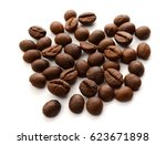 roasted coffee beans on a white ... | Shutterstock . vector #623671898