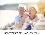 senior couple relaxing by the... | Shutterstock . vector #623697488