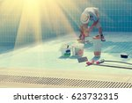 man in a hat put the tiles on... | Shutterstock . vector #623732315