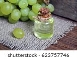 grape seed oil in a glass jar... | Shutterstock . vector #623757746