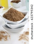 Small photo of GROUND CHINESE FIVE SPICE POWDER IN SMALL SQUARE BOWL,STACK OF THREE ON TABLETOP