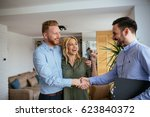 Small photo of Portrait of financial adviser congratulating to a young couple for buying a new house.