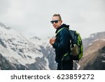 young man with backpack...   Shutterstock . vector #623859272