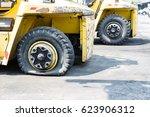 flat tire of heavy equipment...   Shutterstock . vector #623906312