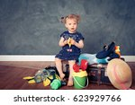 little girl sitting on a... | Shutterstock . vector #623929766