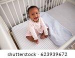 portrait of happy baby girl... | Shutterstock . vector #623939672