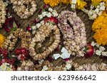 Background Thai style flower garlands that wither after worship of Buddhism by faith and tradition.