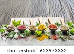 assortment of colorful spices... | Shutterstock . vector #623973332