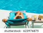 woman relaxing at the poolside... | Shutterstock . vector #623976875