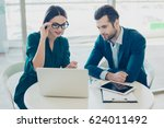 two colleagues discussing new... | Shutterstock . vector #624011492