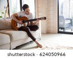 pretty young man playing guitar ... | Shutterstock . vector #624050966