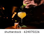 making the cocktail with lime... | Shutterstock . vector #624070226