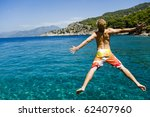 young man jumping off a boat ...   Shutterstock . vector #62407960