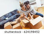 Young Couple Moving Into Their...