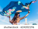 Woman Holding Floating Fabric...