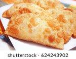 chebureks  fried cakes | Shutterstock . vector #624243902