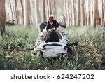 man backpacker lying on the... | Shutterstock . vector #624247202