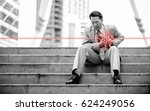 Small photo of Business man having heart attack or heart failure at the steps in front of his office building