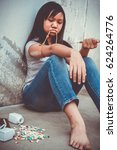 Small photo of Concept Asia young girl is sad by drug addiction. Drug addiction in adolescence.
