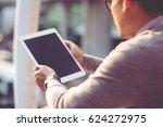 rear view business man using... | Shutterstock . vector #624272975