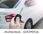 male holding car keys with car... | Shutterstock . vector #624290516