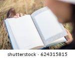 reading book  | Shutterstock . vector #624315815