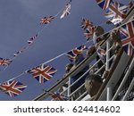 Small photo of On board P&O Cruises MV Oriana, July 23, 2015: Landscape view of a number of men and women at a deck party waving British flags. More flags are seen on bunting against the background of a blue sky
