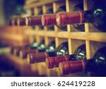 red wine bottles stacked on... | Shutterstock . vector #624419228