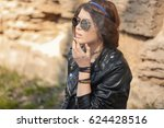 beautiful young woman smoking... | Shutterstock . vector #624428516